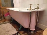 Cast iron roll top bath claw feet
