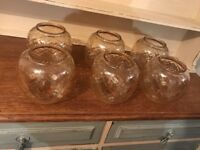 6x glass vintage light shades could be used as candle holders