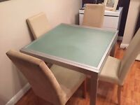 Extendable Glass dining table and 4 chairs
