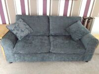 Very clean as new sofa and chair suite. Grey fabric with cusions about 10 months old. fire protected
