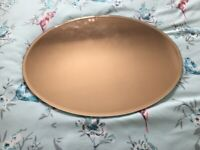Rose gold oval mirror
