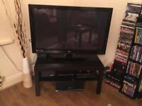 Tv stand, large black table and small coffee table