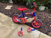 Kids bike with stabilisers and rubber wheels - first bike