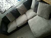 Super fabric corner sofa, less than a year old, Delivery Possible too.