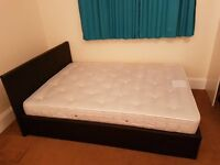 Black faux leather double size bed (frame + John Lewis mattress)