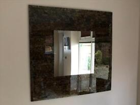 Mirror with decorative surround