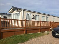 FOR SALE STATIC CARAVAN 42FT X 13FT SITED AT SILVER SANDS LOSSIEMOUTH SITE FEES PAID TILL FEB 19