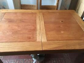 Reduced!! Beautiful solid oak extending table and 4 chairs