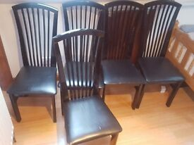 5 black dining chairs