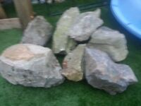 Stones suitable for garden rockery. 2 x black/dark grey and 8 lighter grey