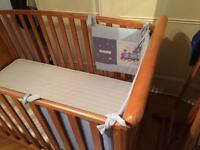 Solid cot bed