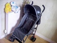 SELDOM USED. BLACK BUGGY SUITABLE FROM BIRTH TO 3 YRS **FREE DELIVERY WITHIN HULL**