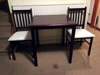 Modern, dark wood table and 2 chairs in very good condition!