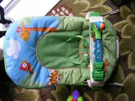 fisher price rainforest floor gym/bounce and vibration chair.