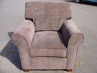 Lugano armchair, roll arms chair, in very good condition, light brown made of high quality fabric.