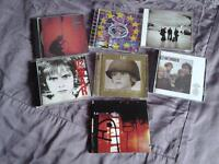 Collection of CD's by U2.