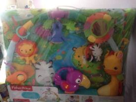 Brand new fisher price rainforest music and lights deluxe gym