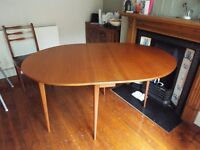 Solid wood oval drop leaf dining table