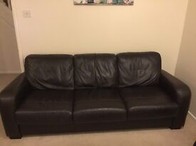 Dark brown leather sofa, only one year old (bought new). No marks or scratches. 4 year guarantee.