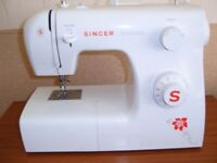 Singer Sewing machine as new nerver been used with asseseris
