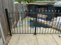 Wrought iron garden fence with 2 gates and 8 posts