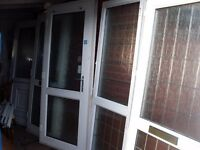 large bundle of upvc doors and french doors and many spares