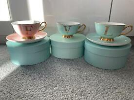 Teacup X3 and 2 saucers