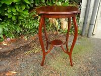 Small Table in genuine rich red Mahogany Wood. 29 ins High. Top 24ins at widest.