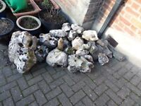 around 30 flintstones,some large,some with holes,ideal rockery,pond etc