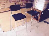 A pair of black and silver breakfast bar chairs