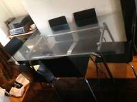 6 ikea chairs and glass table