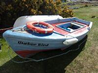 Clinker dinghy heavily fibreglassed