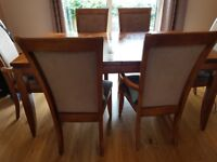 £40 Table 6 chairs, with centre leaf for extension.