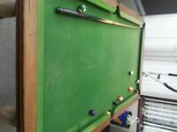 Old pool table for sale decent condition for age some cues included