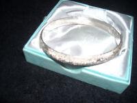 Silver bracelet stamped 925.