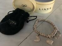 Links of London bracket with few charms
