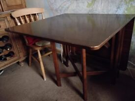 Gate legged dark wood dining table
