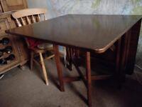 Gate legged dark wood dining table