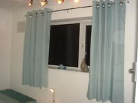 Next eyelet curtains in light pastel blue