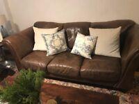 Beautiful three-seat chocolate brown leather sofa