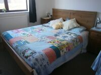 Ikea bed (approx. Queen size) including mattress and 2 beside tables