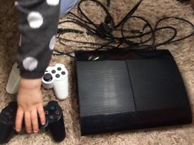 PlayStation 3 with 13 games and two controllers