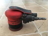 Snap on palm sander