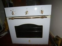 Built gas oven.