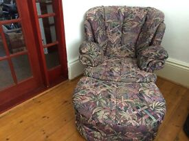 Armchair with matching separate footstool/ Fabric multi coloured pattern. Good Condition.