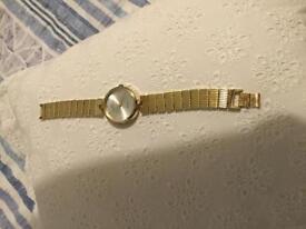 Unisex gold bracelet watch