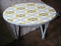 Shabby chic oval side table in grey with retro style paper on top
