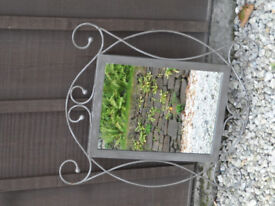 Ornamental mirror grey metal frame