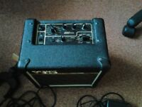Vox Amplifier, guitar lead and guitar wall bracket