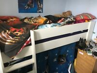 Cabin bed with pirate curtain
